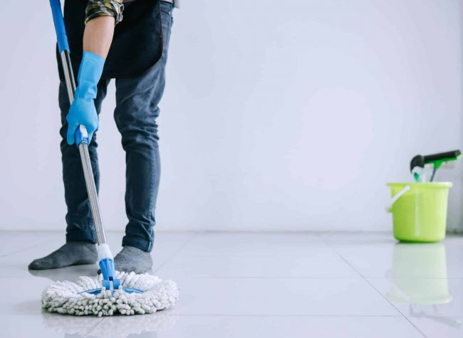 husband-housekeeping-and-cleaning-concept-happy-young-man-in-blue-rubber-gloves-wiping-dust-using-mop_t20_Kv12QE (1)